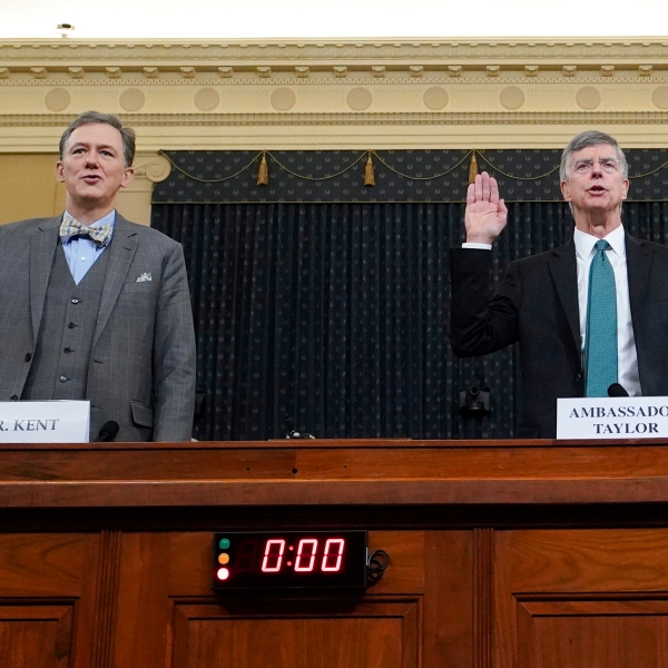 Deputy Assistant Secretary for European and Eurasian Affairs George P. Kent and top U.S. diplomat in Ukraine William B. Taylor Jr. are sworn-in prior to testifying before the House Intelligence Committee on Capitol Hill November 13, 2019 in Washington, DC. (Credit: Joshua Roberts - Pool/Getty Images)