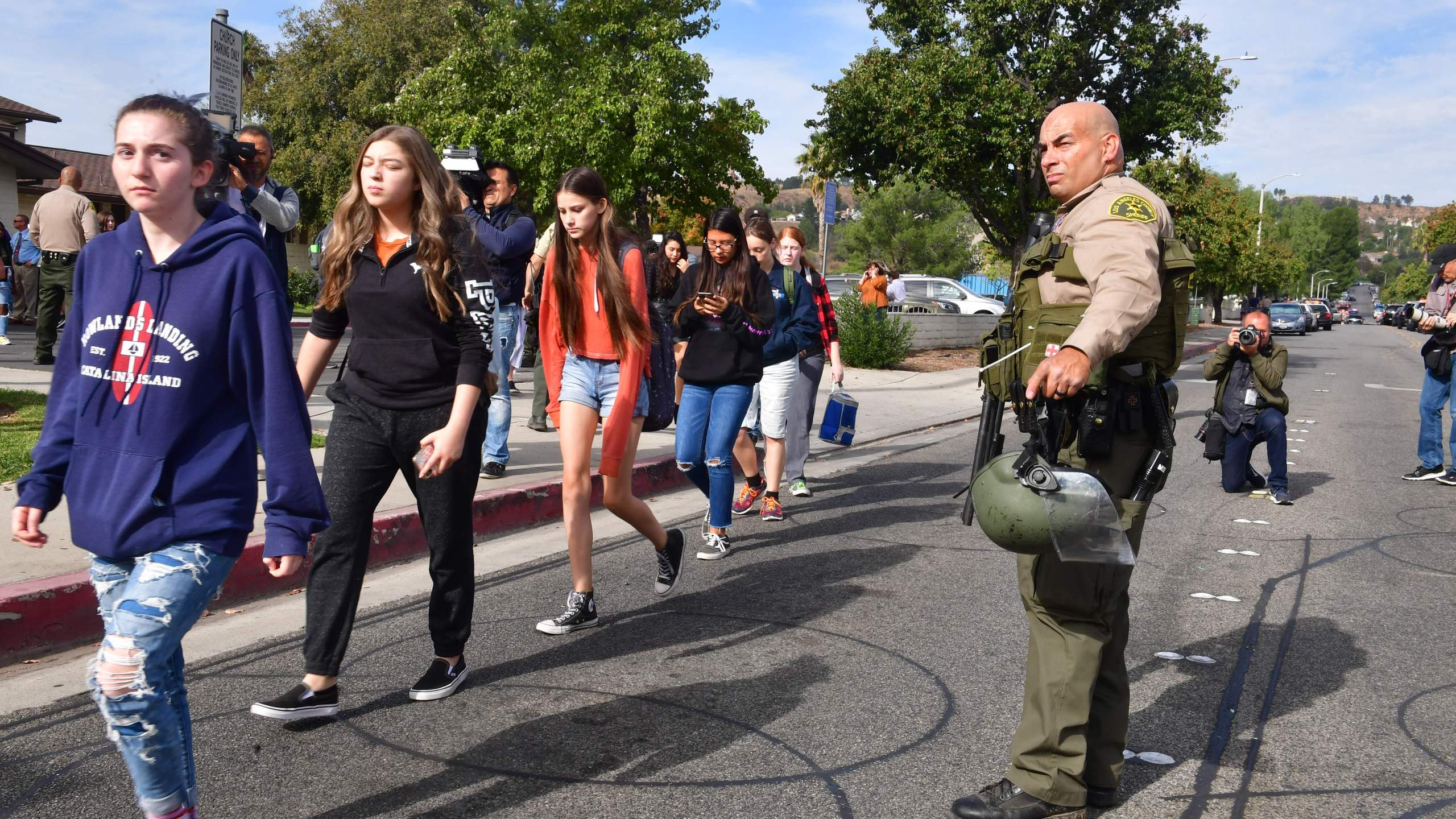 Students line up after a shooting at Saugus High School in Santa Clarita on Nov. 14, 2019. (Credit: FREDERIC J. BROWN/AFP via Getty Images)