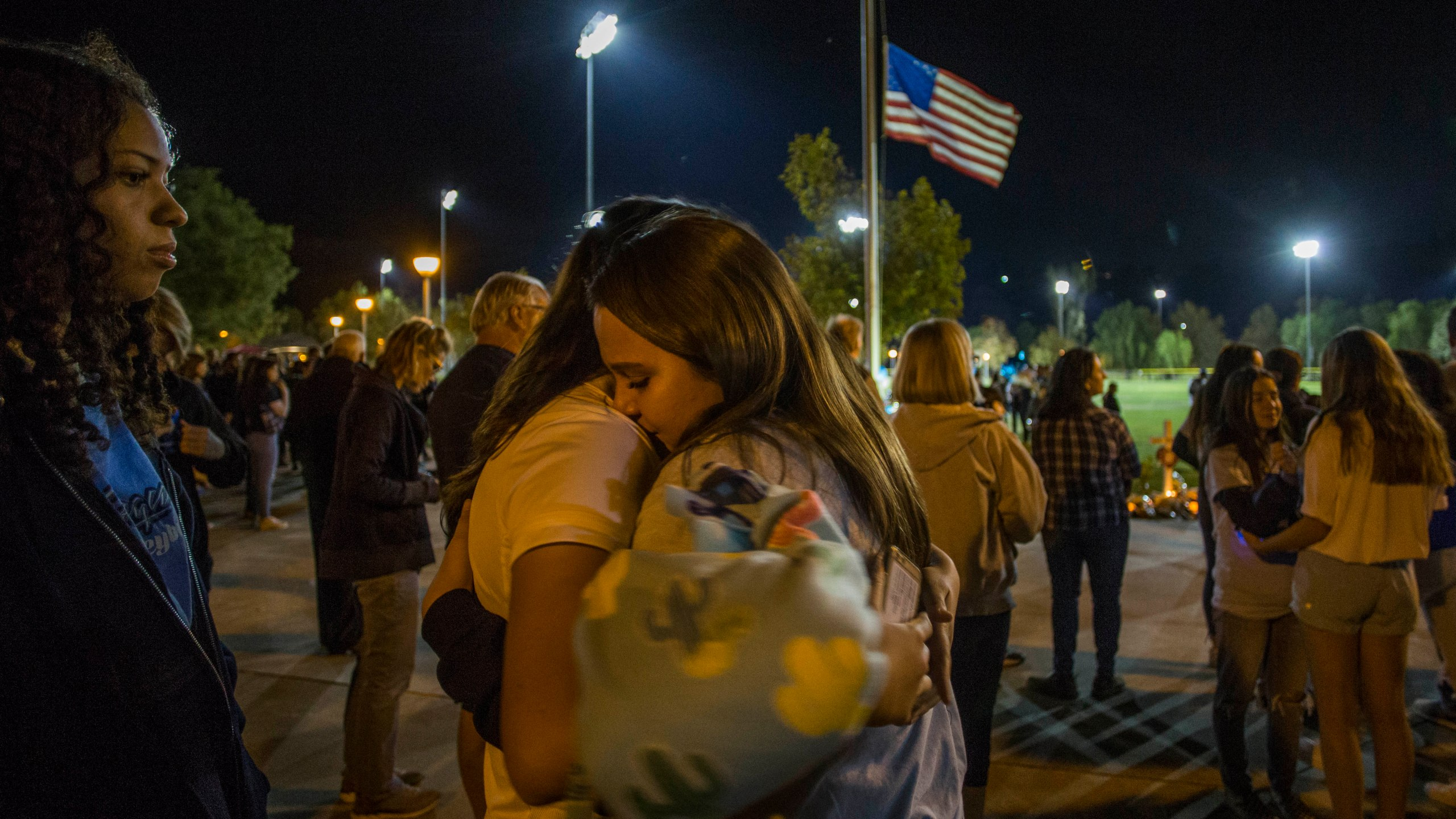 Mourners hug at a vigil held for shooting victims on Nov. 17, 2019 in Santa Clarita. (Credit: Apu Gomes/Getty Images)