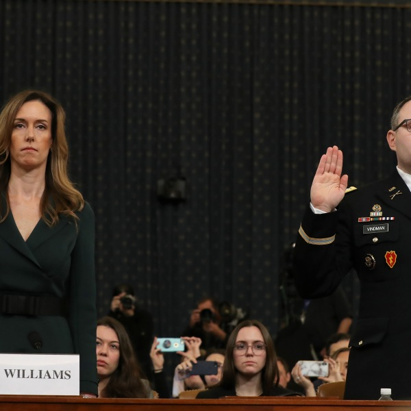 Jennifer Williams, adviser to Vice President Mike Pence for European and Russian affairs, and National Security Council Director for European Affairs Lt. Col. Alexander Vindman are sworn in to testify before the House Intelligence Committee in the Longworth House Office Building on Capitol Hill November 19, 2019. (Credit: Chip Somodevilla/Getty Images)