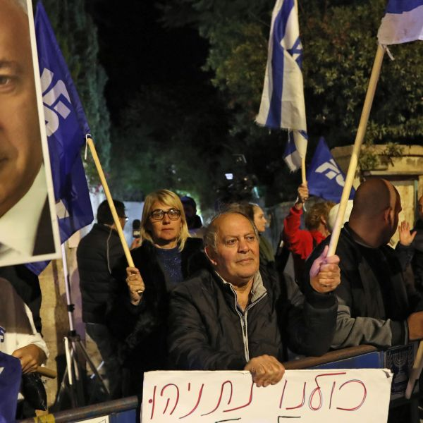 Supporters of Israeli Prime Minister Benjamin Netanyahu chant slogans as they demonstrate their solidarity with him outside his official residency in Jerusalem on Nov. 21, 2019. (Credit: GALI TIBBON/AFP via Getty Images)