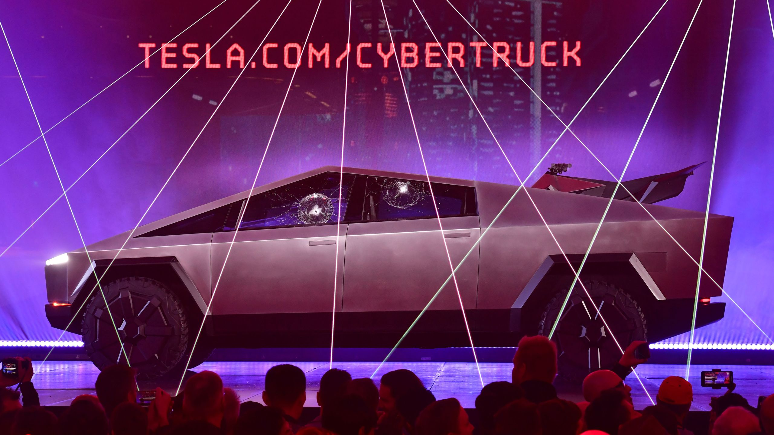 People take pictures of the newly unveiled all-electric battery-powered Tesla's Cybertruck with shattered windows after a failed resistance test, at Tesla Design Center in Hawthorne on Nov. 21, 2019. (Credit: FREDERIC J. BROWN/AFP via Getty Images)