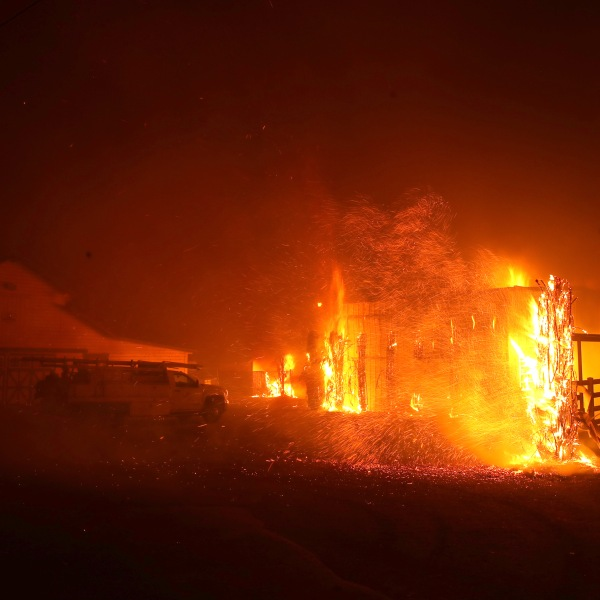 The Kincade Fire burns a structure on Oct. 27, 2019, in Santa Rosa, California. (Credit: Justin Sullivan/Getty Images)
