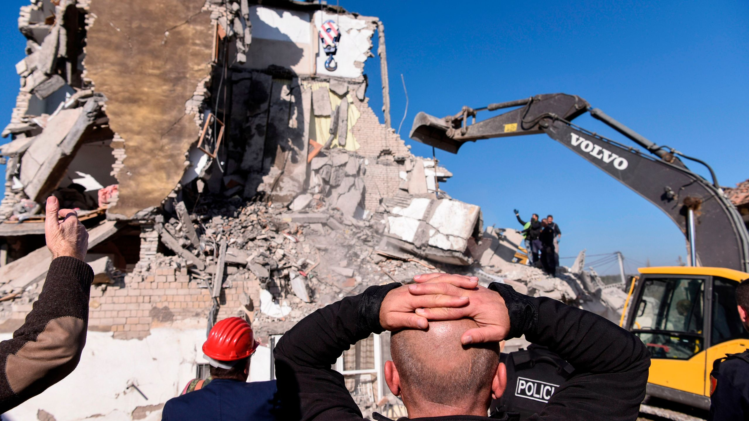 Rescue workers remove debris from a collapsed building in Thumane, northwest of capital Tirana, after an earthquake hit Albania, on November 26, 2019. (Credit: ARMEND NIMANI/AFP via Getty Images)