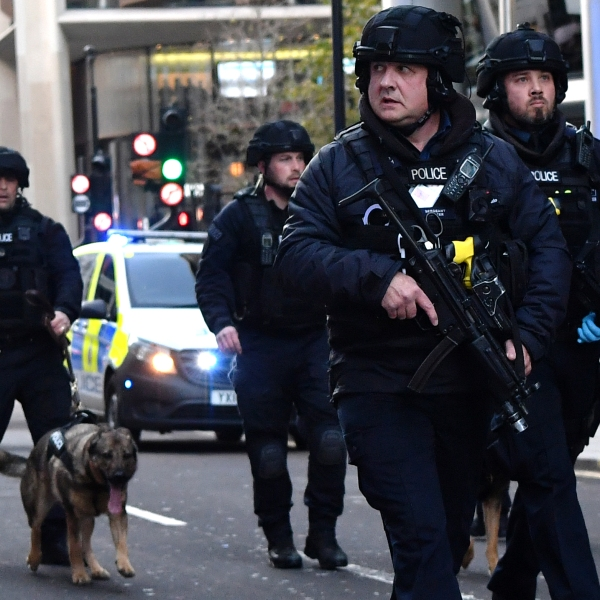 Armed police with dogs patrol along Cannon Street in central London after a stabbing attack on the London Bridge on Nov. 29, 2019. (Credit: Ben Stansall / AFP / Getty Images)