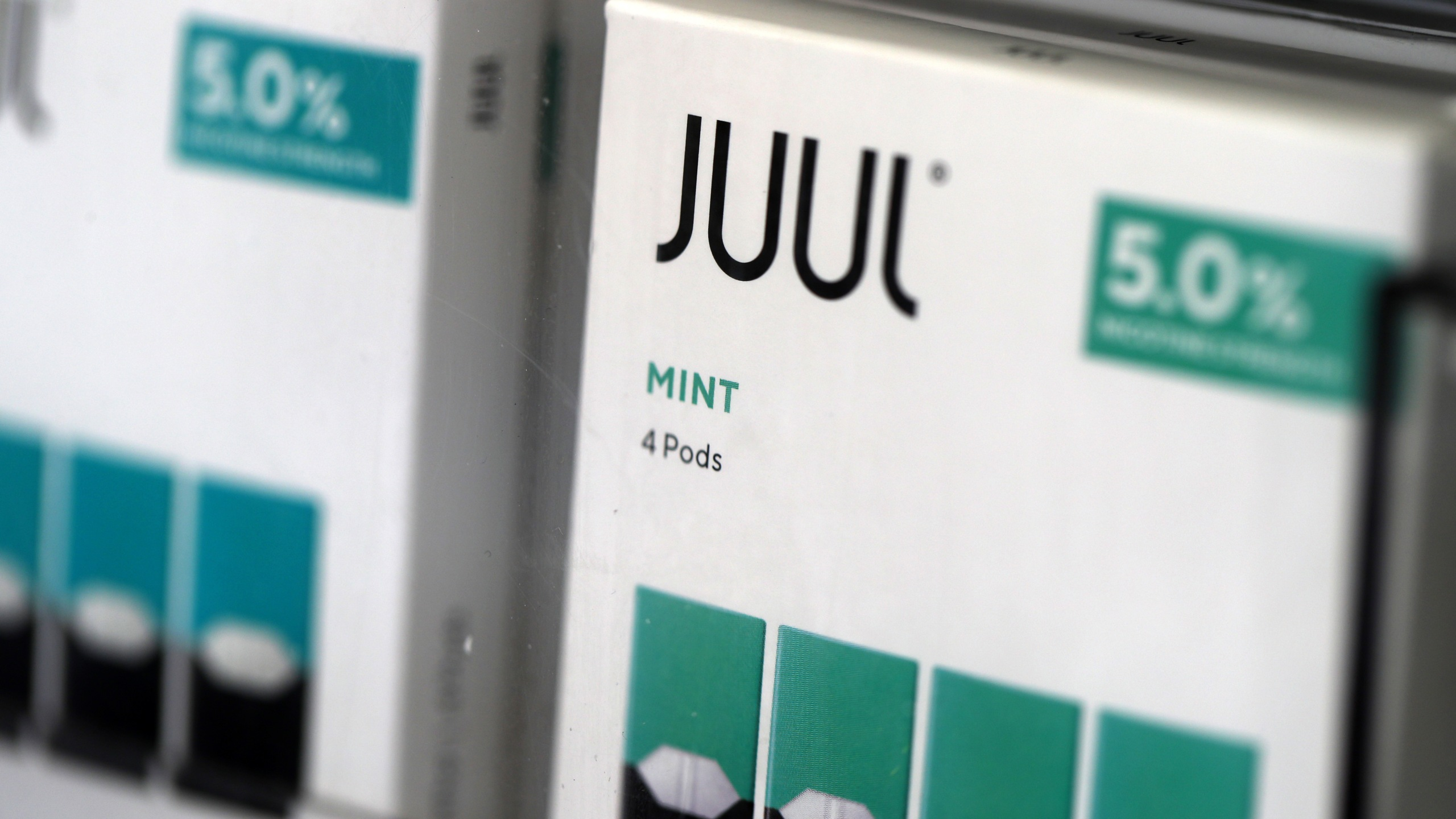 Packages of Juul mint flavored e-cigarettes are displayed at a smoke shop in San Rafael on Nov. 7, 2019. (Credit: Justin Sullivan / Getty Images)