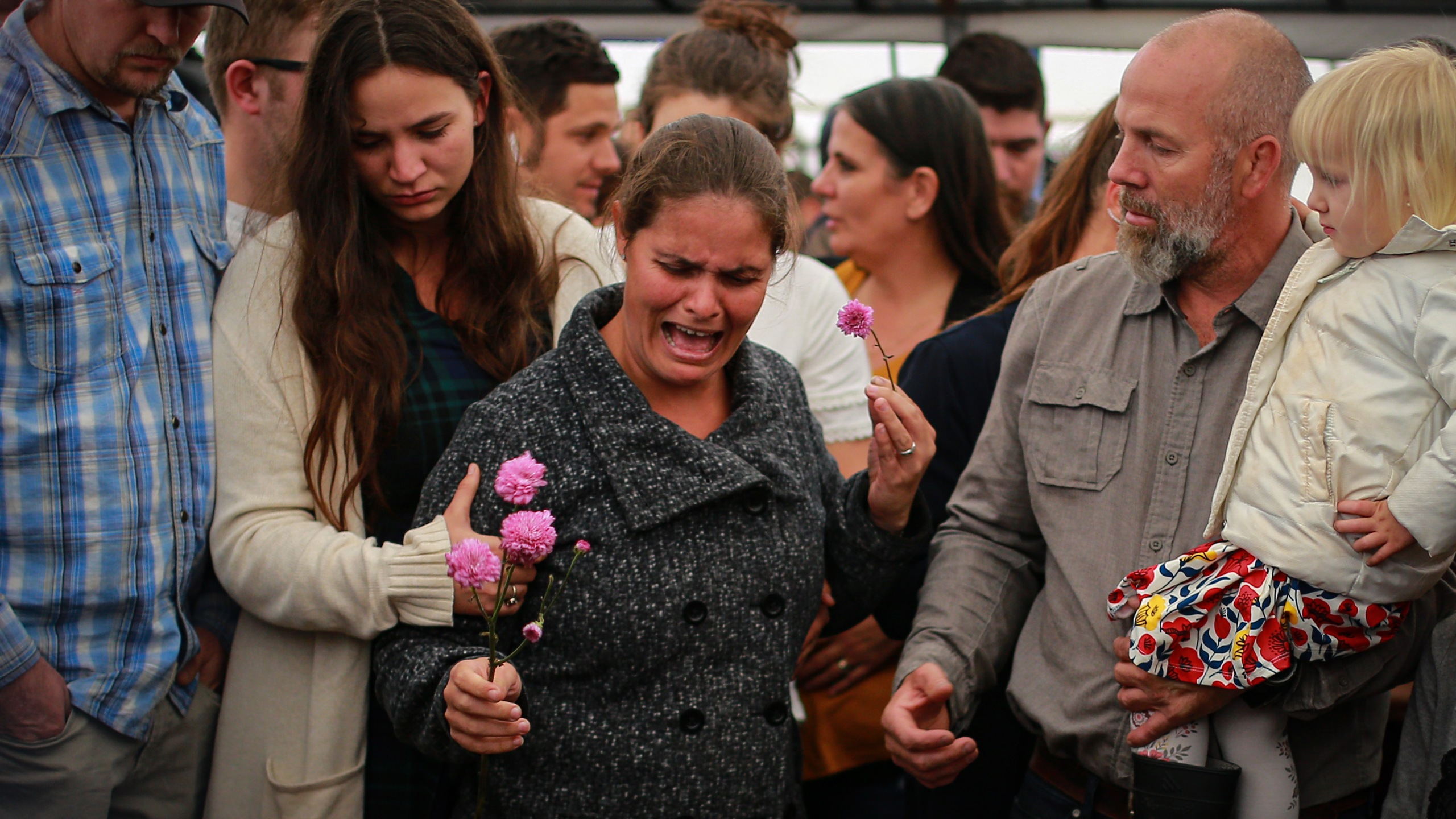 Friends and relatives of the extended Le Baron family mourn members killed in a violent attack during a funeral on Nov. 8, 2019, in Le Barón, Mexico. (Credit: Manuel Velasquez/Getty Images)