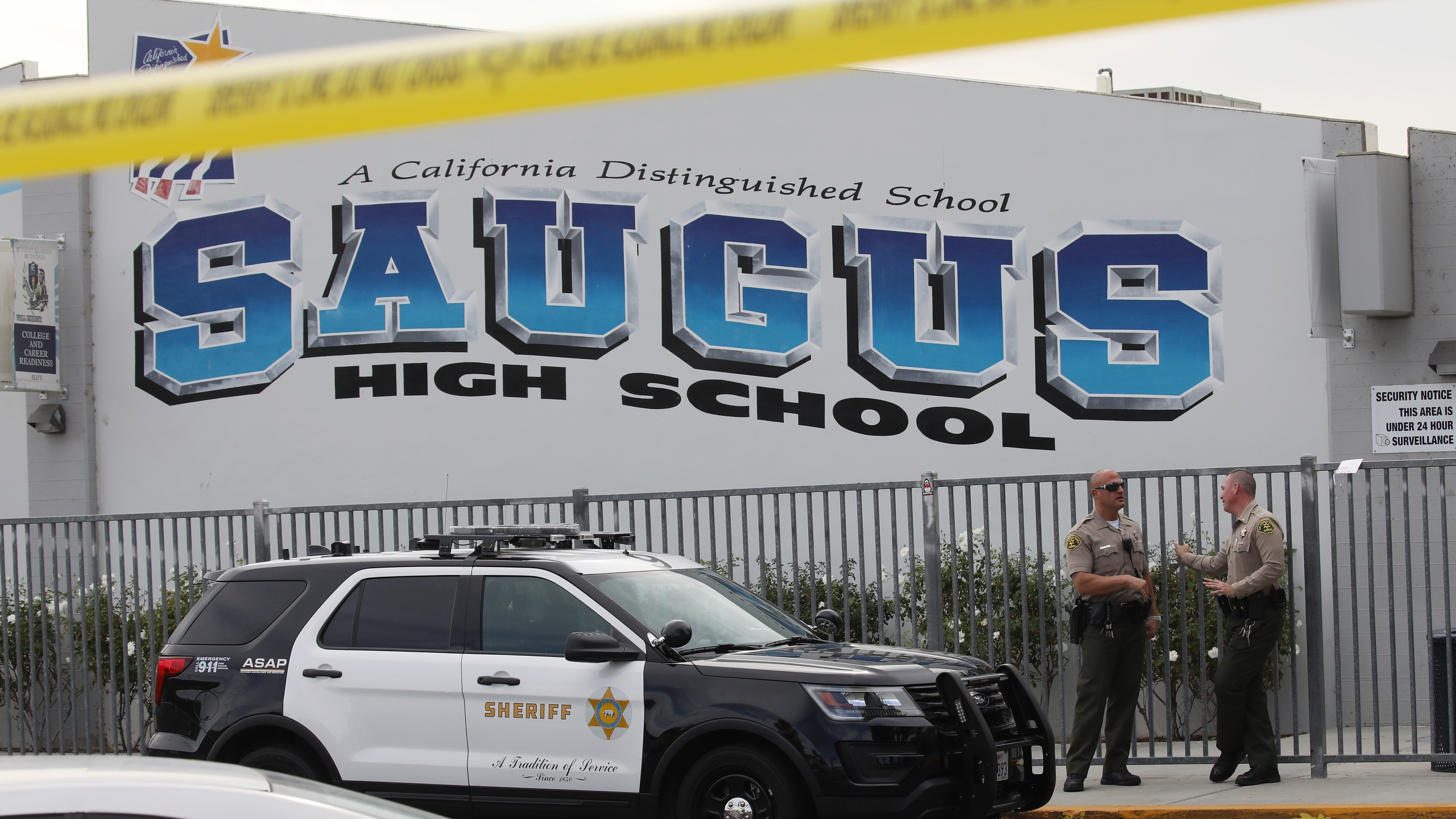 L.A. County sheriff's deputies are positioned at Saugus High School in Santa Clarita on Nov. 15, 2019, a day after a deadly shooting there. (Credit: Mario Tama/Getty Images)