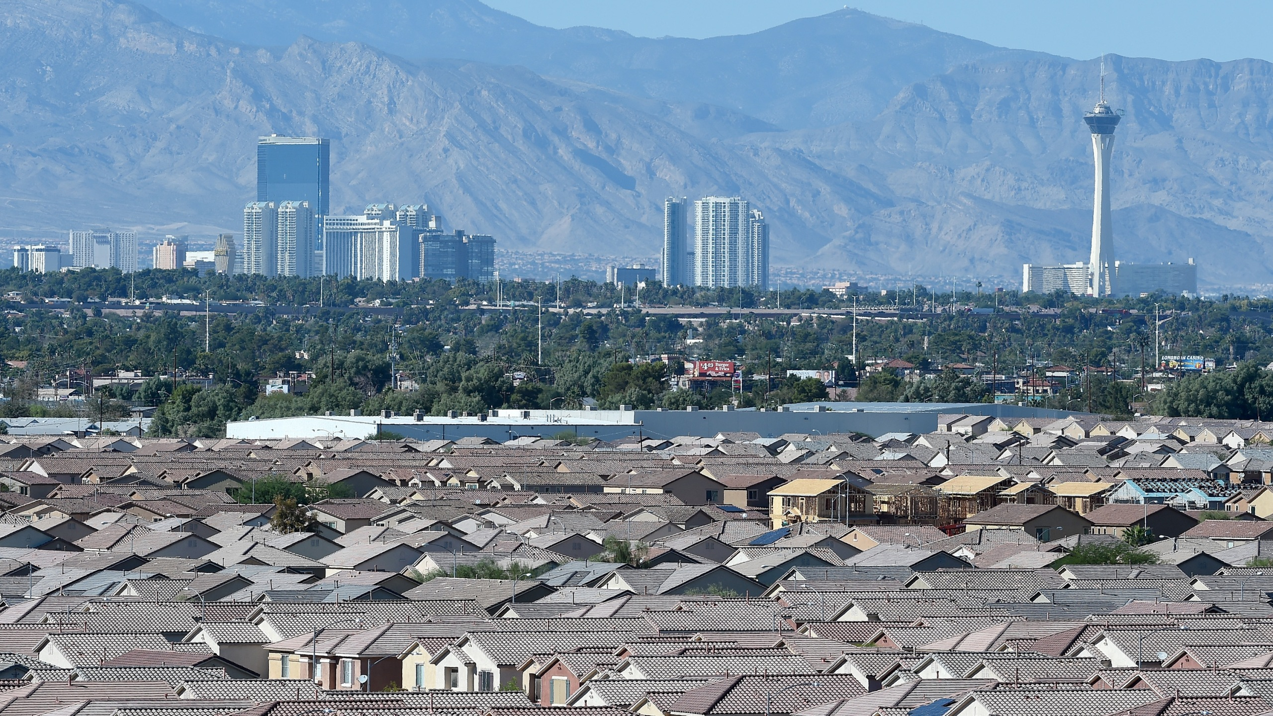 A general view from Sam Boyd Stadium shows the Las Vegas Strip behind homes on Oct. 31, 2015 in Las Vegas, Nevada (Credit: Ethan Miller/Getty Images)