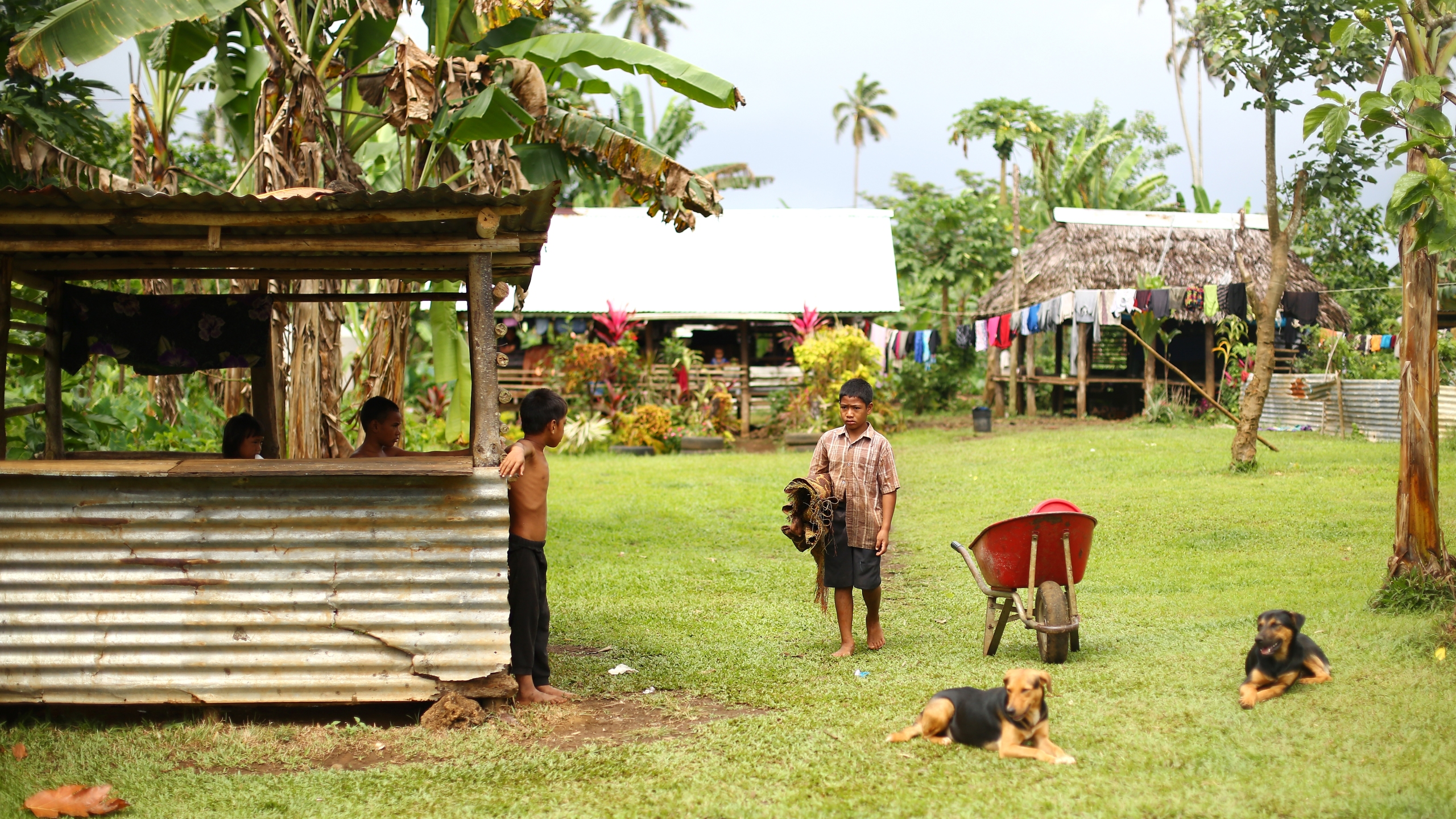 Children pose near their home in Sa'agafou, Samoa is this file photo taken on Sept. 12, 2015. (Credit: Mark Kolbe/Getty Images)