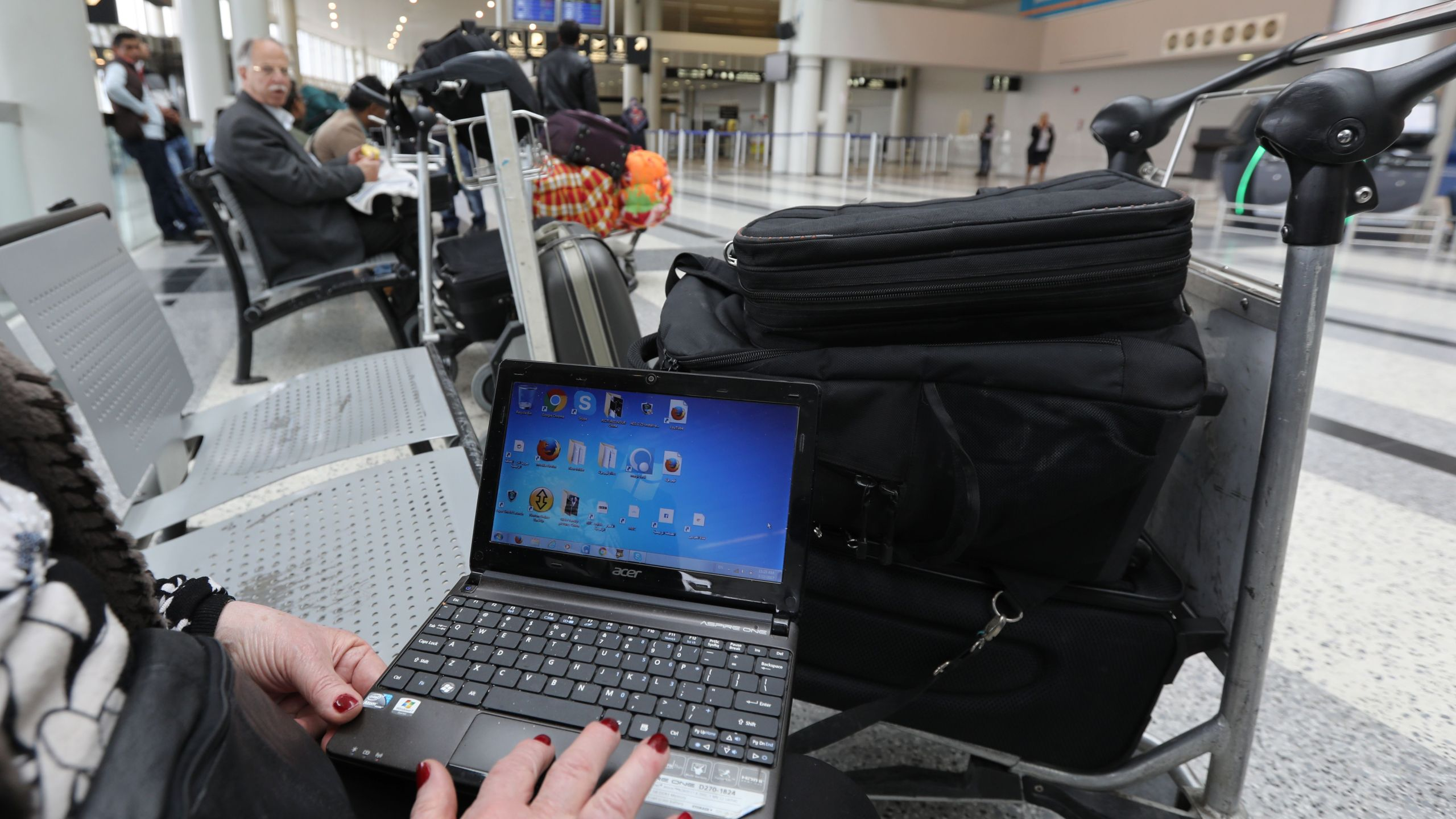 A Syrian woman travelling to the U.S. opens her laptop before checking in at Beirut international airport in Lebanon on March 22, 2017.(Credit: Anwar Amro / AFP / Getty Images)