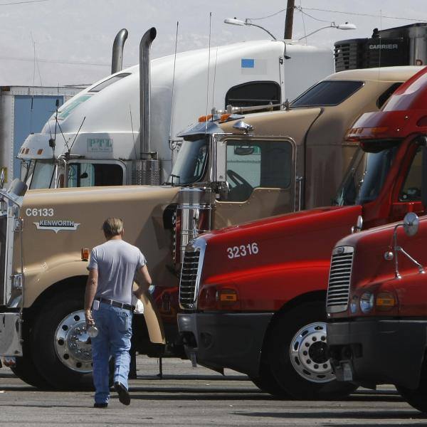 A trucker walks back to his truck at a fueling depot in Oak Hills on April 1, 2008. (Credit: Robyn Beck/AFP via Getty Images)