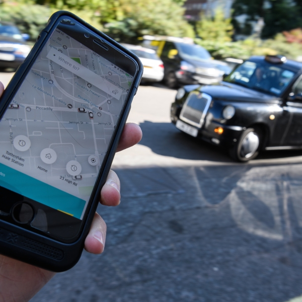 In this photo Illustration, the Uber app is displayed on a phone on Sept. 22, 2017 in London. (Credit: Leon Neal/Getty Images)