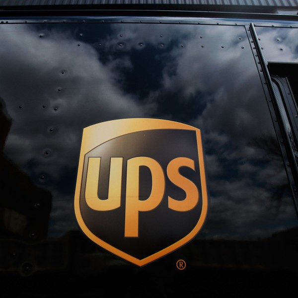 The United Parcel Service logo is emblazoned on the side of a delivery truck seen on April 23, 2009, in New York City. (Credit: Chris Hondros/Getty Images)