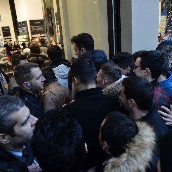 People wait outside a department store in Thessaloniki on November 24, 2017. (Credit: SAKIS MITROLIDIS/AFP via Getty Images)