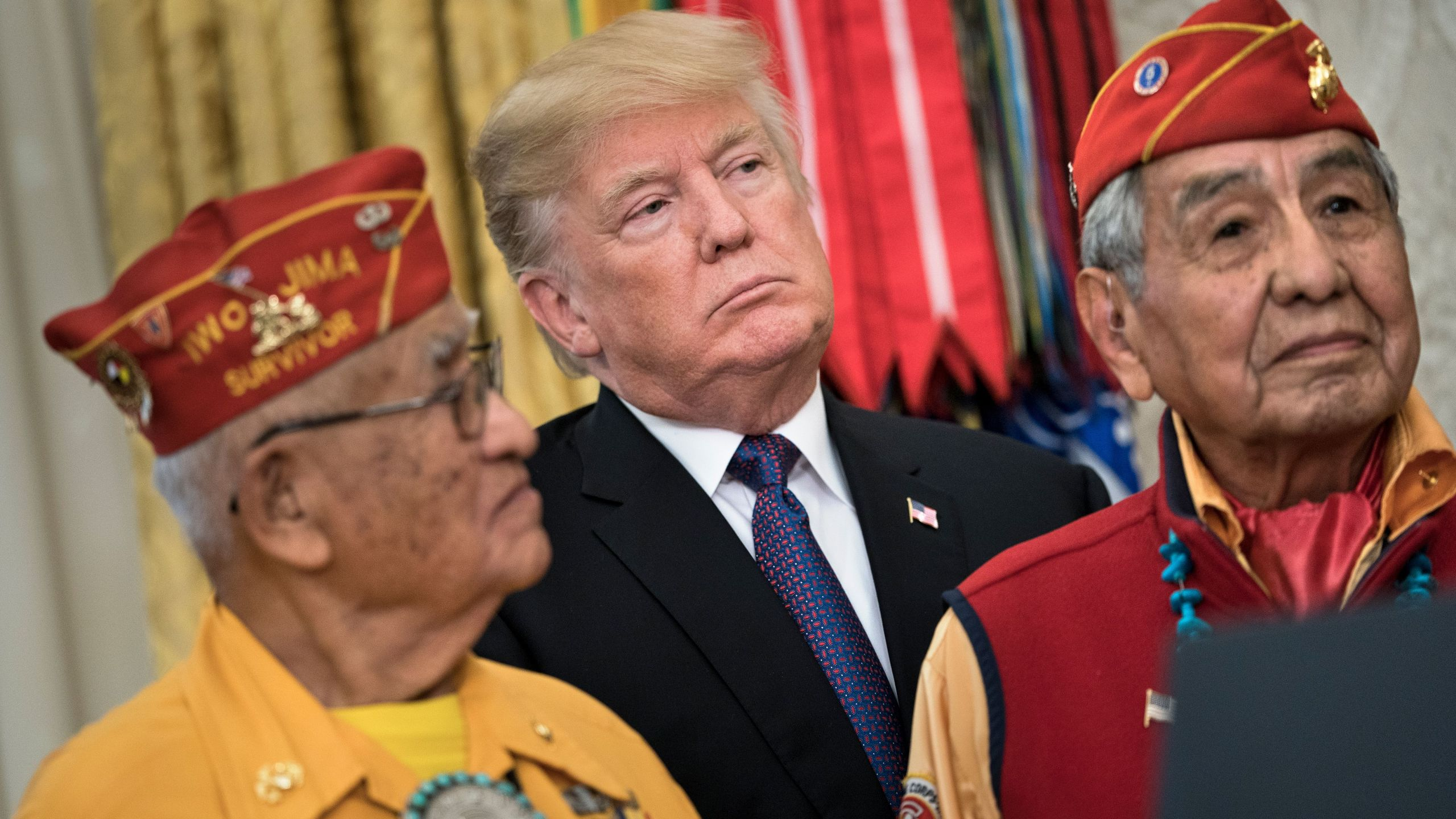 President Donald Trump listens with Navajo code talkers in the Oval Office during an event to honor Native American code talkers who served in World War II on Nov. 27, 2017. (Credit: Brendan Smialowski / AFP / Getty Images)