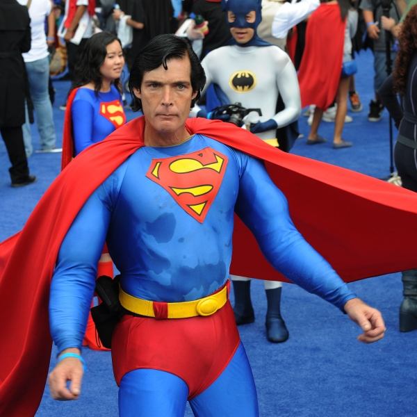 Christopher Dennis dressed as Superman joins the crowd of 1,580 costumed superheroes during the successful attempt to break the Guinness World Record for the largest gathering of superheroes outside the Staples Center in Los Angeles on Oct. 2, 2010. (Credit: Mark Ralston / AFP / Getty Images)