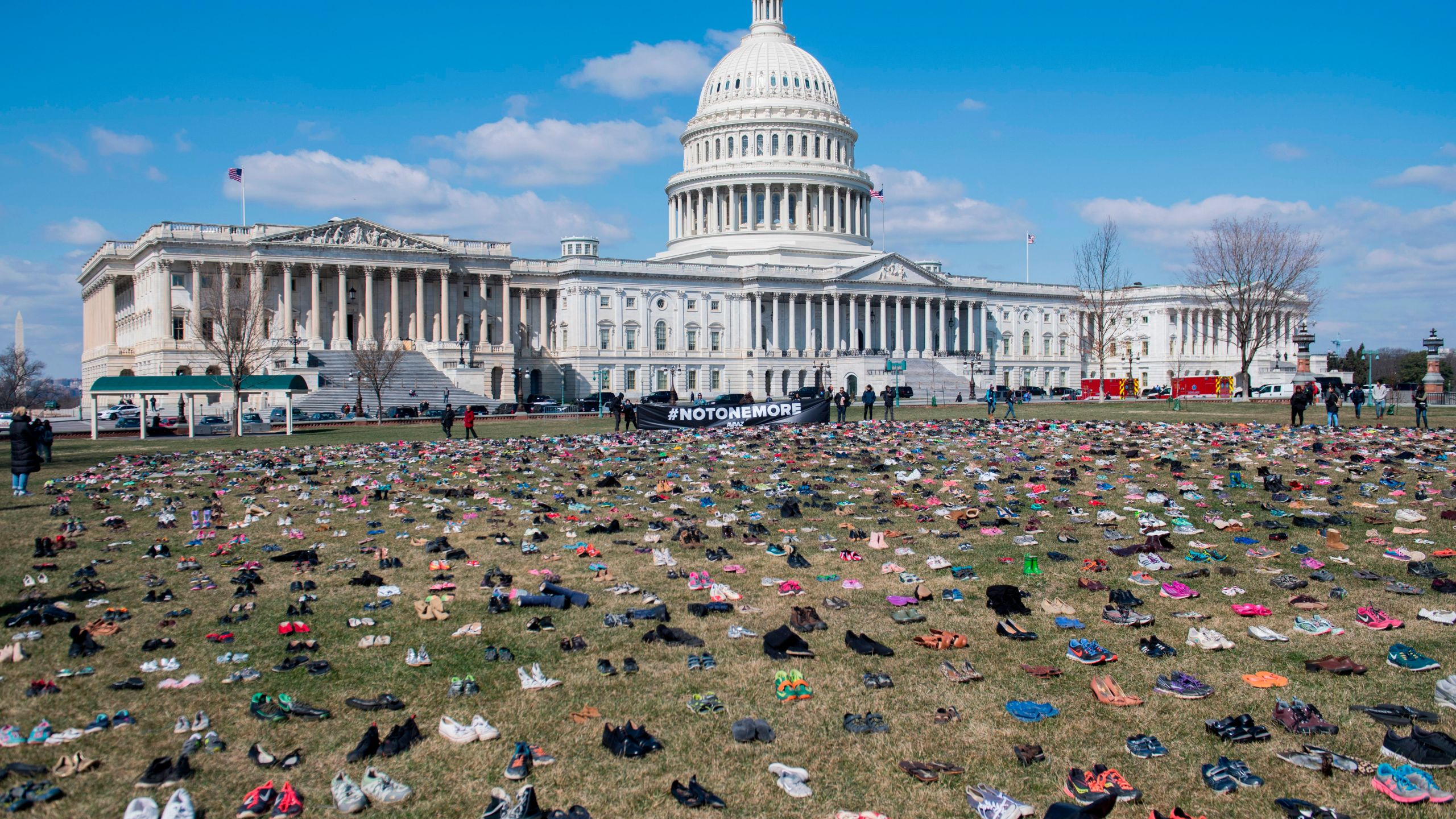 The lawn outside the U.S. Capitol is covered with 7,000 pairs of empty shoes to memorialize children killed by gun violence since the Sandy Hook school shooting on March 13, 2018. (Credit: Saul Loeb/AFP via Getty Images)
