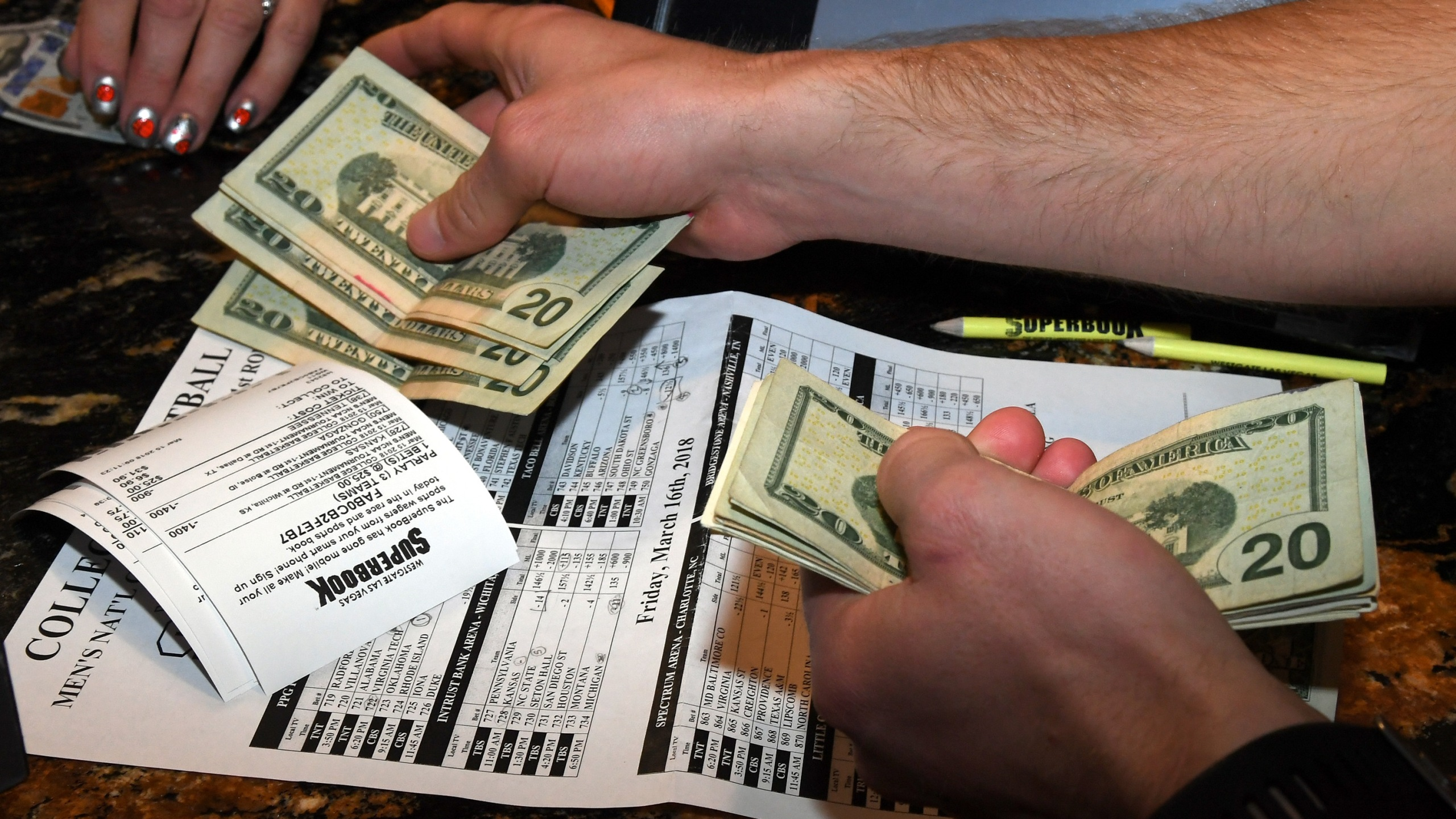 Jake Sindberg of Wisconsin makes bets during a viewing party for the NCAA Men's College Basketball Tournament inside the Westgate Las Vegas Resort & Casino in Las Vegas on March 15, 2018. (Credit: Ethan Miller / Getty Images)