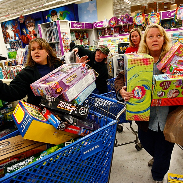 "Shoppers Jeri Hull (L) and Karen Brashear (R) wait in line while shopping at Toys""R""Us during the Black Friday sales event on November 27, 2009 in Fort Worth, Texas. (Credit: Tom Pennington/Getty Images)"