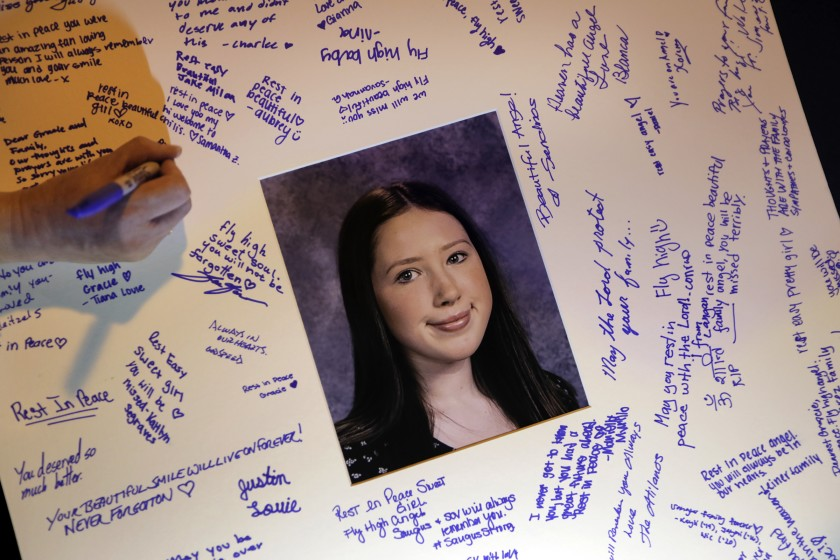 Students sign a card in memory of Gracie Anne Muehlberger, one of two students killed in the shooting on Nov. 14, 2019, at Saugus High School in Santa Clarita.(Credit: Carolyn Cole / Los Angeles Times)