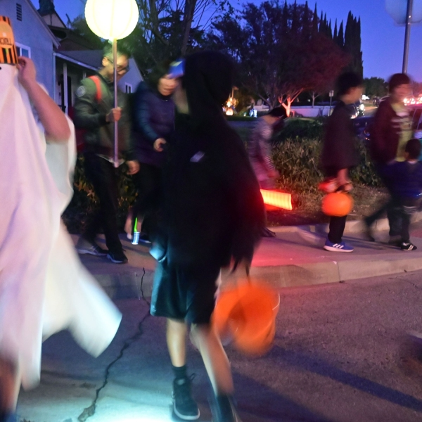 Children go trick or treating on Halloween night in Monterey Park on October 31, 2019. (Credit: FREDERIC J. BROWN/AFP via Getty Images)