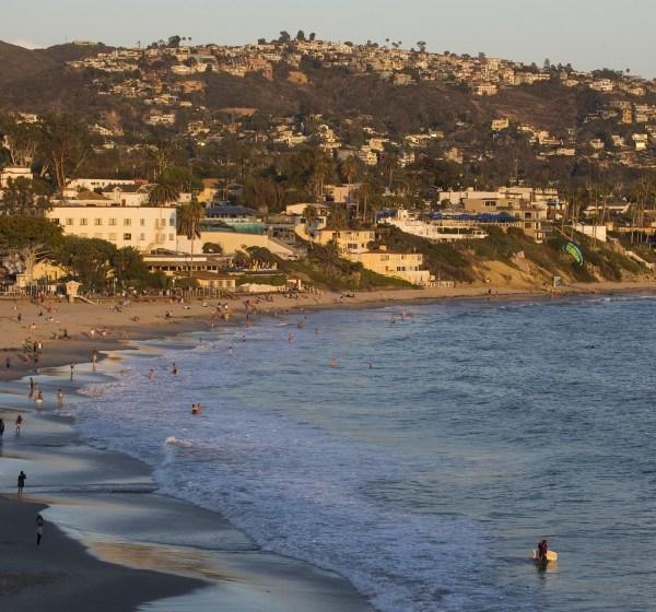 Beachgoers are seen at Laguna Beach in an undated photo. (Credit: Allen J. Schaben / Los Angeles Times)