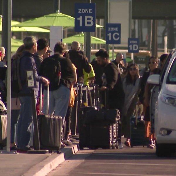 Travelers leave LAX on Nov. 3, 2019. (Credit: KTLA)