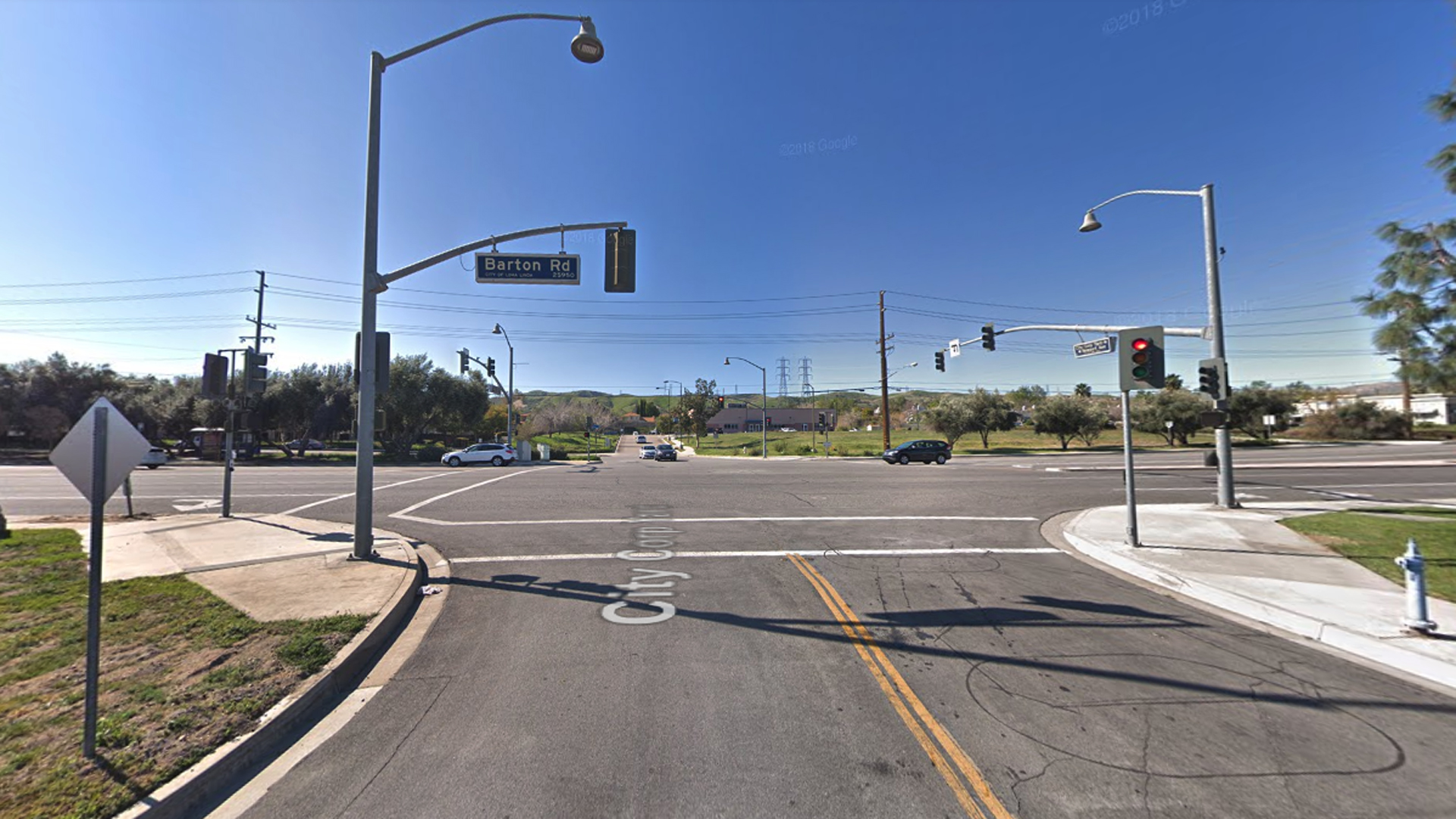 The intersection of Barton Road and Newport Avenue in Loma Linda, as viewed in a Google Street View image.