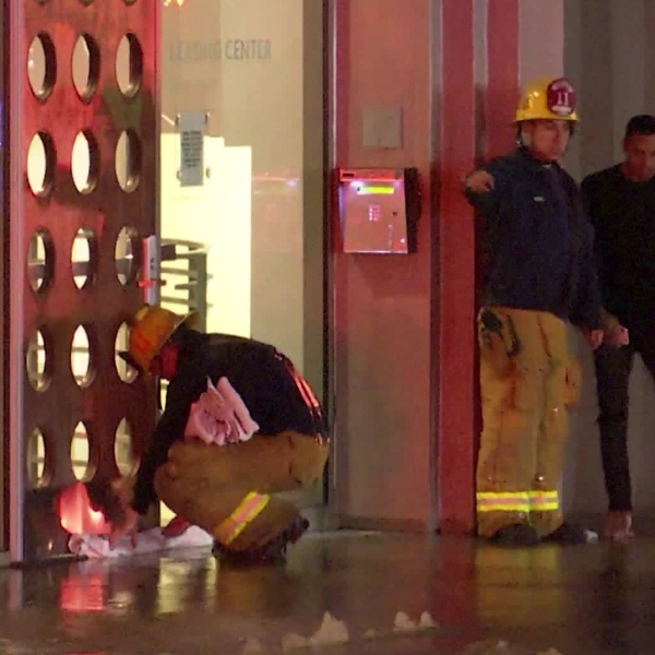 A broken water main flooded the lobby of a Westlake District apartment building on Nov. 18, 2019. (Credit: OnScene.TV)