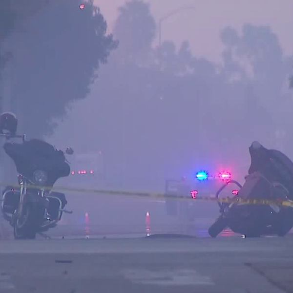 Two motorcycles lie in the middle of the road in Carson after three riders were shot at nearby on Nov. 3, 2019. (Credit: KTLA)