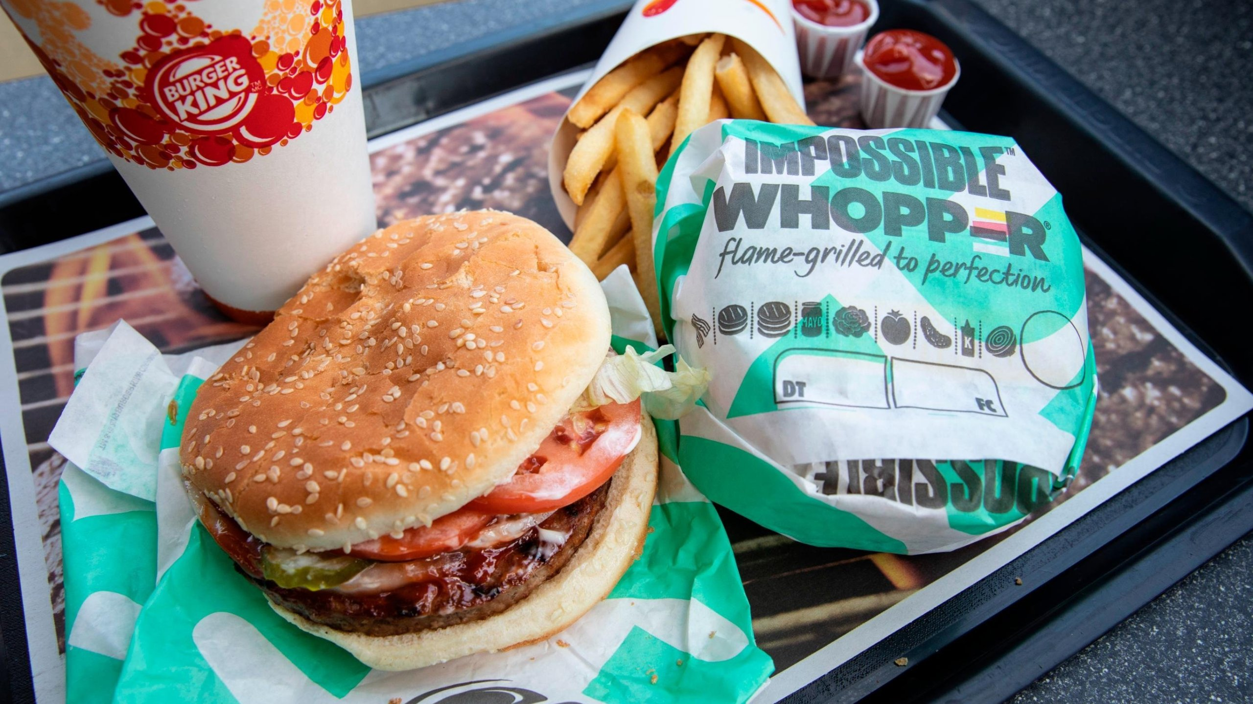 A man is suing Burger King because the meatless Impossible Whopper is cooked on the same grill as meat products, the lawsuit alleges. (Credit: Drew Angerer/Getty Images)