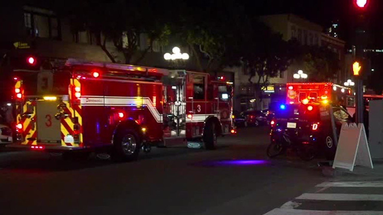 San Diego authorities respond to the scene of a brawl during a Halloween celebration in the Gaslamp Quarter. (Credit: KGTV via CNN)