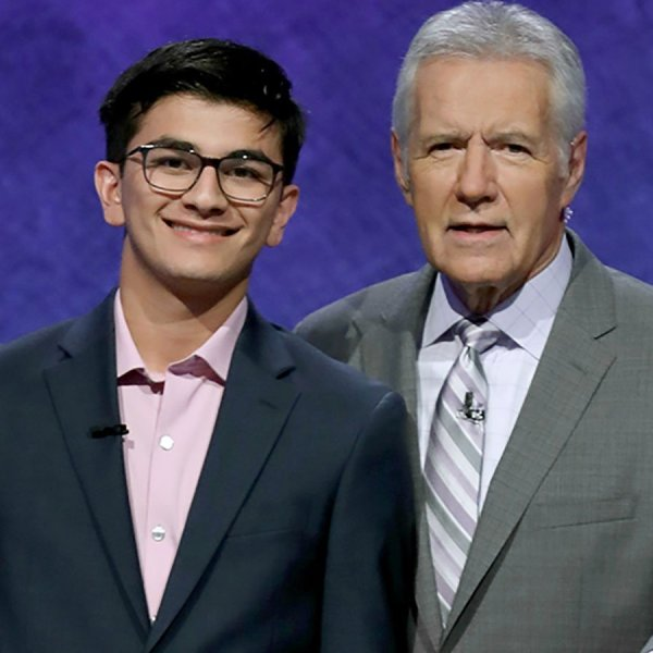 Avi Gupta poses with Alex Trebek in this 2019 photo. (Credit: Jeopardy Productions Inc. via CNN)