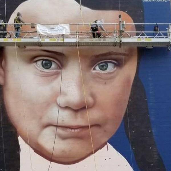 Artists work on a mural of Swedish teenage climate activist, Greta Thunberg, in San Francisco. (Credit: Courtesy One Atmosphere via CNN)