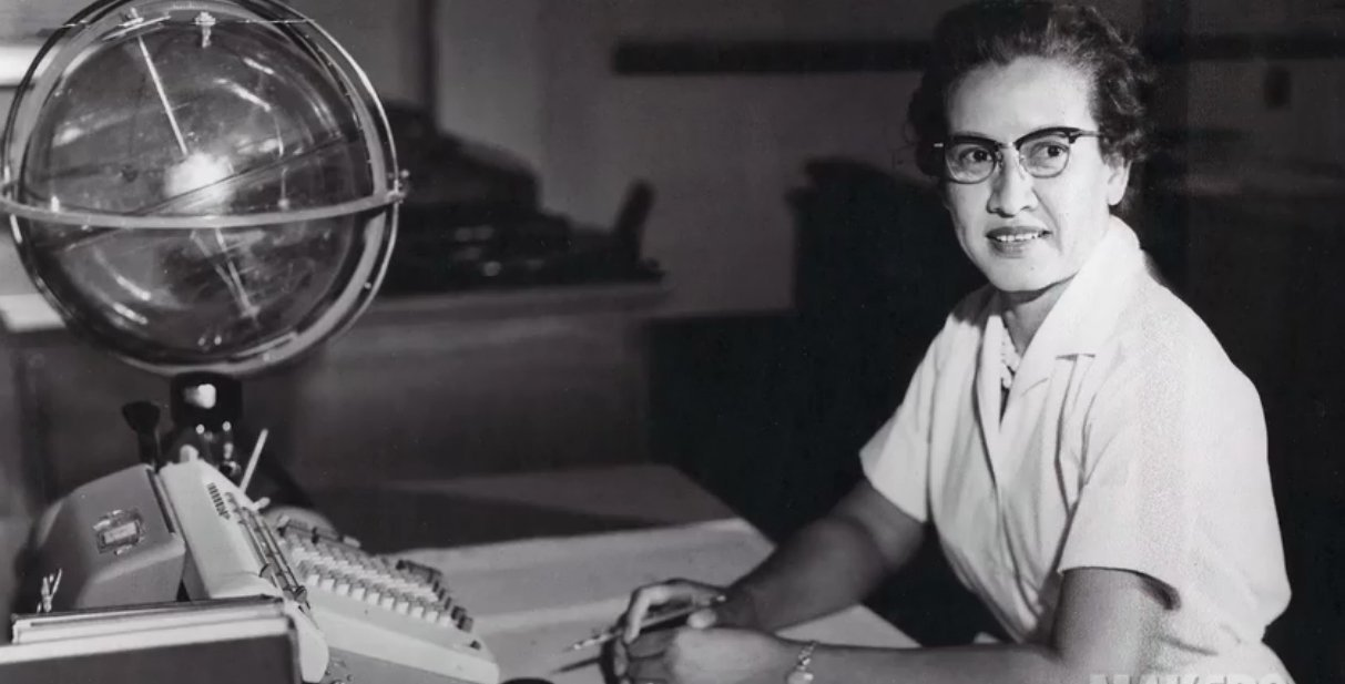 NASA mathematician Katherine Johnson is seen sitting at her desk at the NASA Langley Research Center in this photo from the '60s. (Credit: Sean Smith/NASA via CNN)