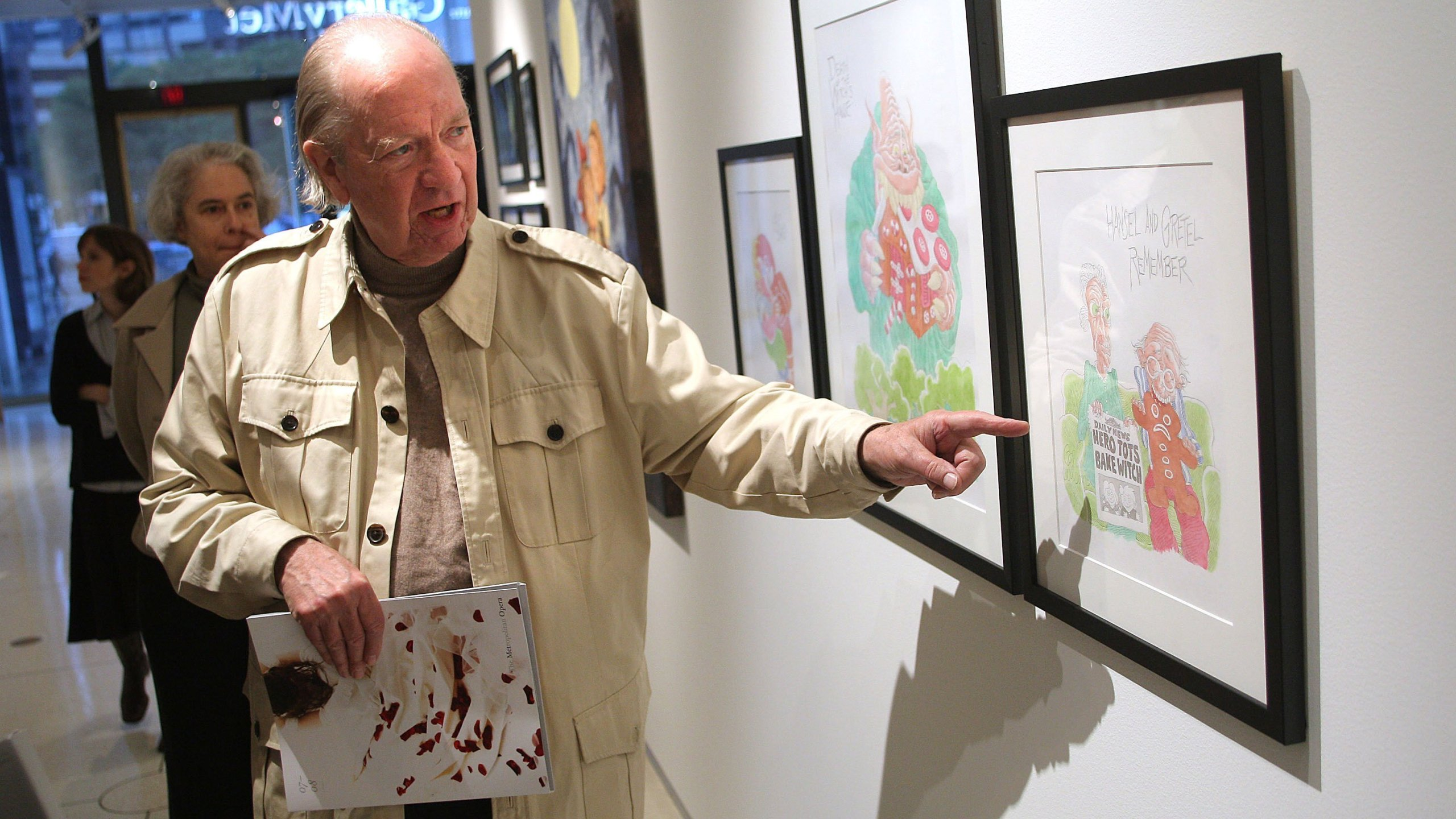Gahan Wilson discusses his piece on display at an exhibit in New York in 2007. (Credit: Scott Gries/Getty Images)