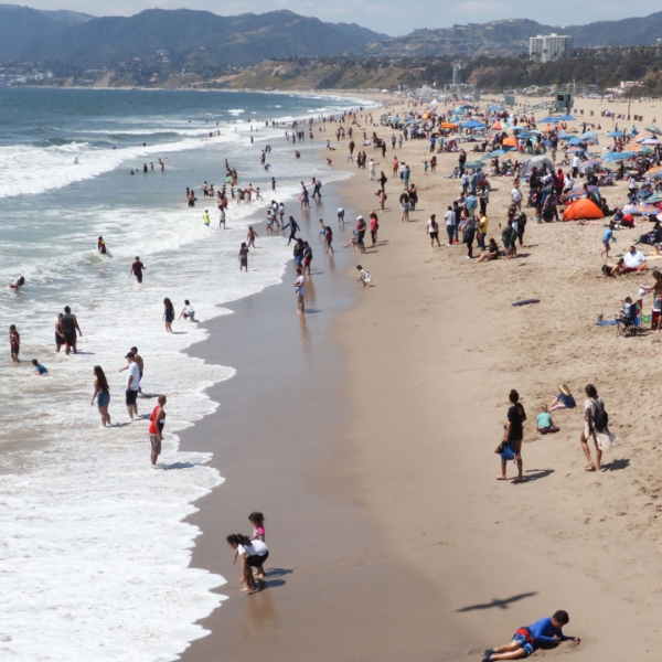 Tourists and Angelenos enjoy the beach in Santa Monica, California, on April 21, 2019. (DANIEL SLIM/AFP via Getty)