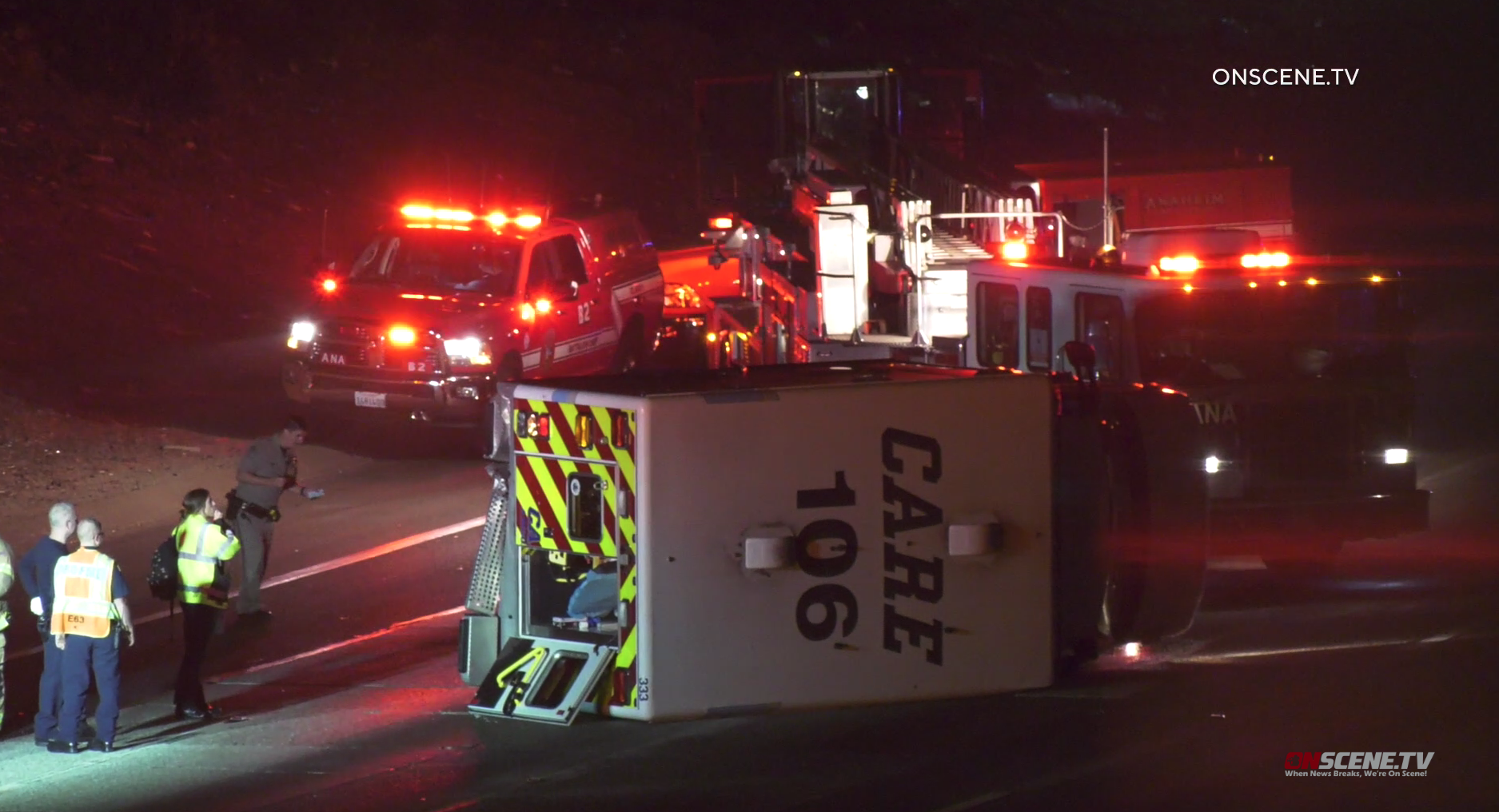 An ambulance is seen tipped over on its side following a hit-and-run crash on the 91 Freeway in Anaheim on Nov. 10, 2019. (Credit: Onscene.TV)