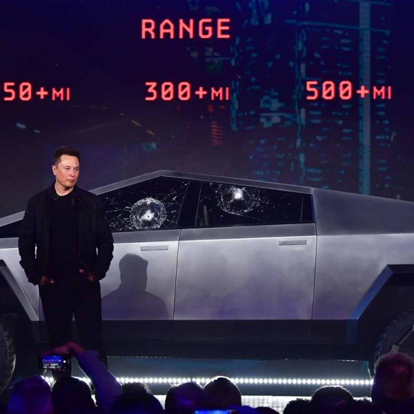 Tesla co-founder and CEO Elon Musk stands in front of the newly unveiled all-electric battery-powered Tesla's Cybertruck at Tesla Design Center in Hawthorne, California on Nov. 21, 2019. (Credit: Frederic J. Brown/AFP/Getty Images)