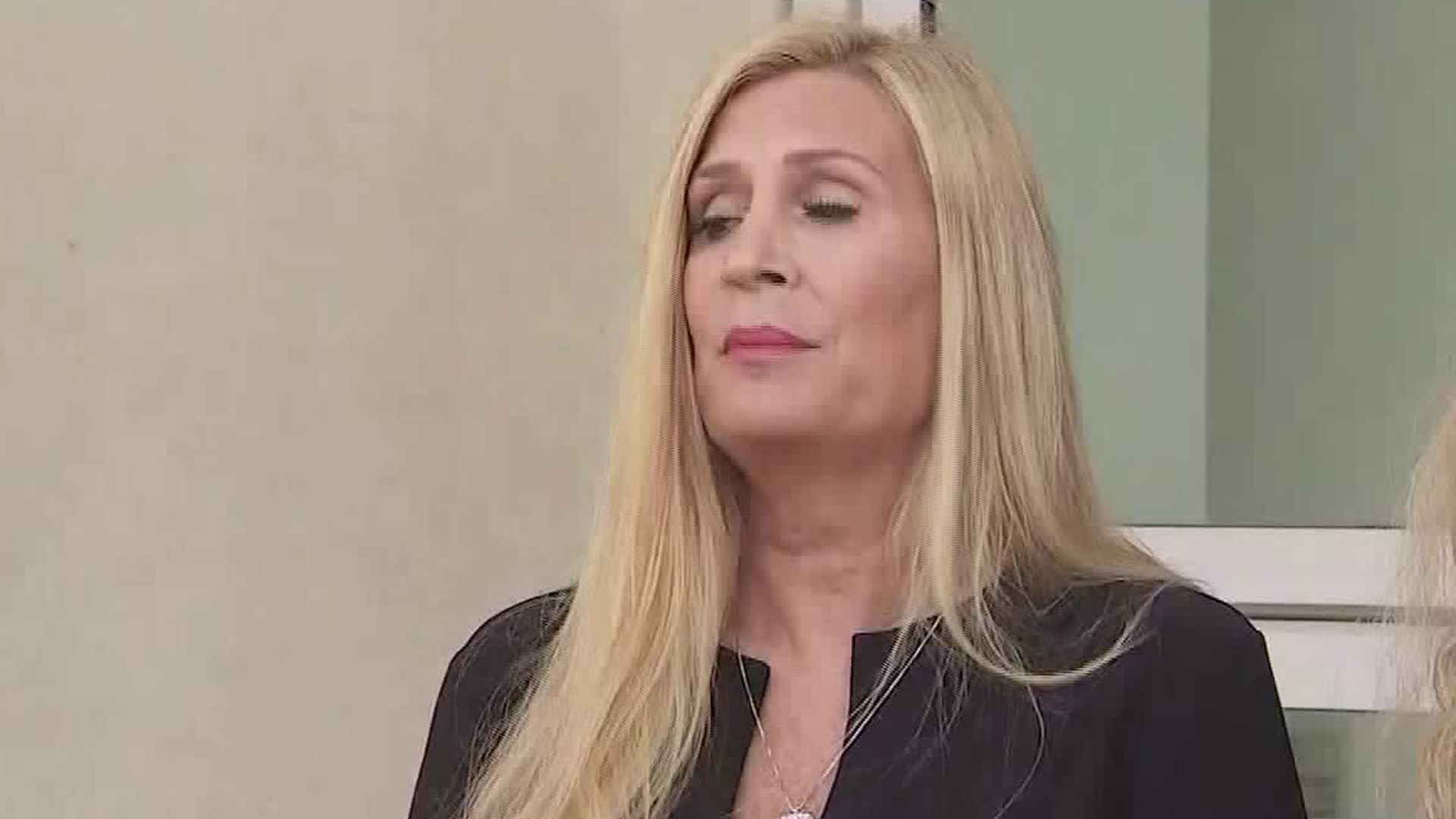 A woman who only identified herself as Julie detailed allegations against James Heaps, a former gynecologist for the University of California Los Angeles, at a news conference in Del Aire on Nov. 6, 2019. (Credit: KTLA)