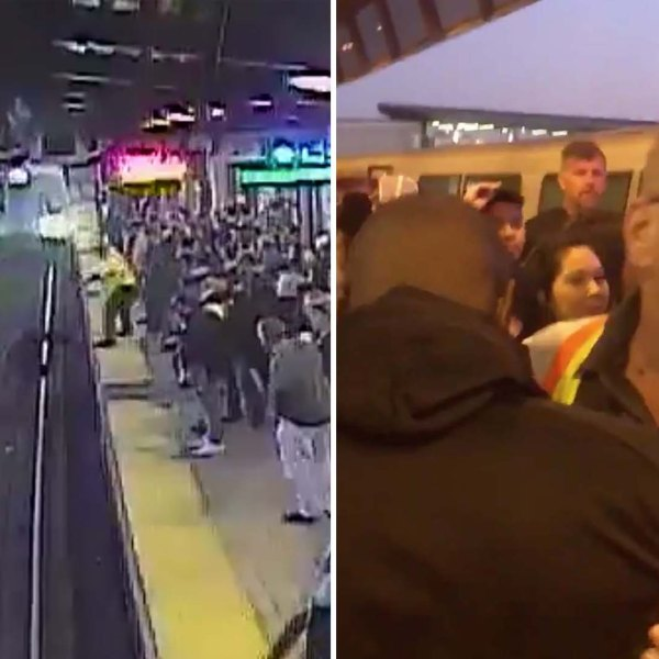 Surveillance video released by BART shows the moment an employee pulled an intoxicated man off the tracks as a train approached on Nov. 3, 2019, and the employee is seen embracing the man he saved. (Credit: Tony Badilla/Twitter via CNN)