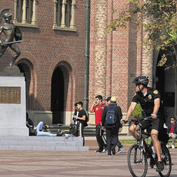A series of student deaths at USC this semester has roiled the university. In this 2012 file photo, officers patrol the campus following a shooting at a party. (Credit: Brian van der Brug / Los Angeles