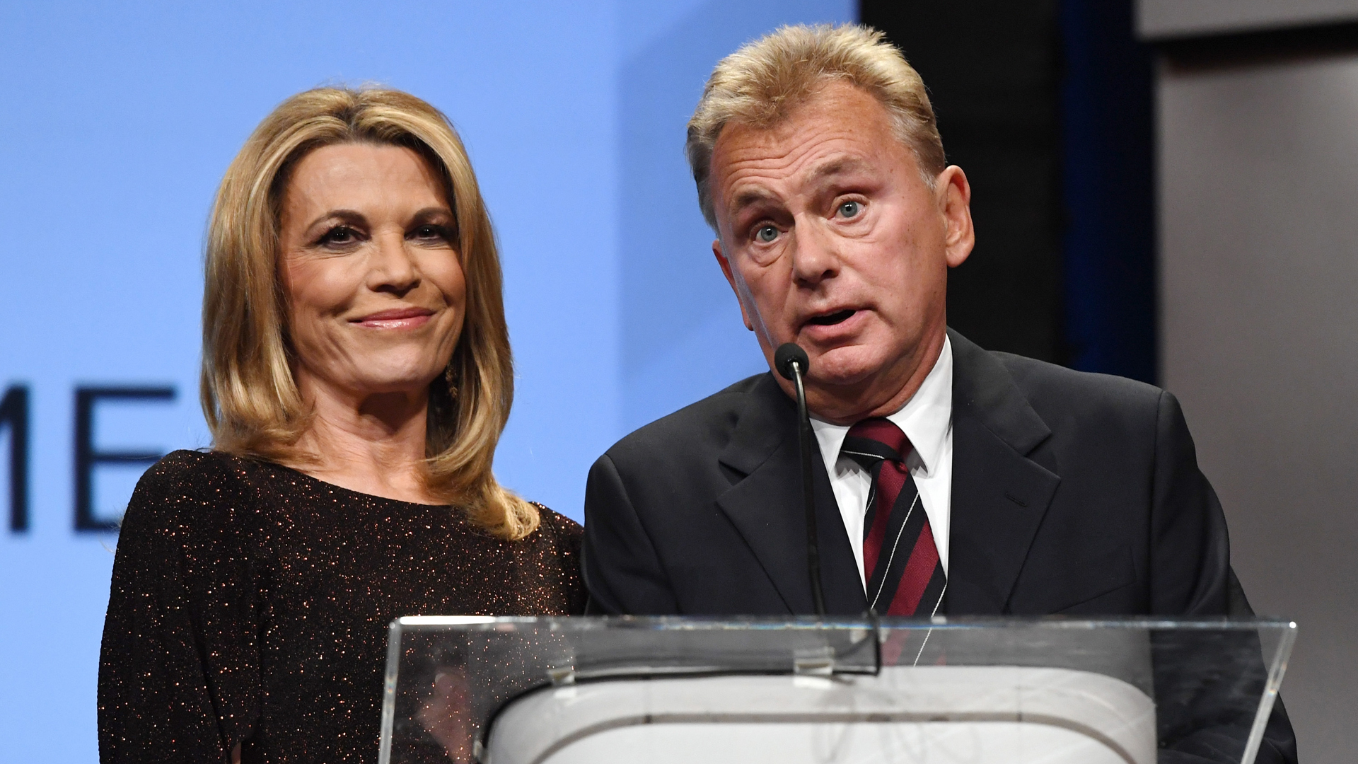 """""""Wheel of Fortune"""" hostess Vanna White (L) and host Pat Sajak speak as they are inducted into the National Association of Broadcasters Broadcasting Hall of Fame during the NAB Achievement in Broadcasting Dinner at the Encore Las Vegas on April 9, 2018 in Las Vegas, Nevada. (Credit: Ethan Miller/Getty Images)"""