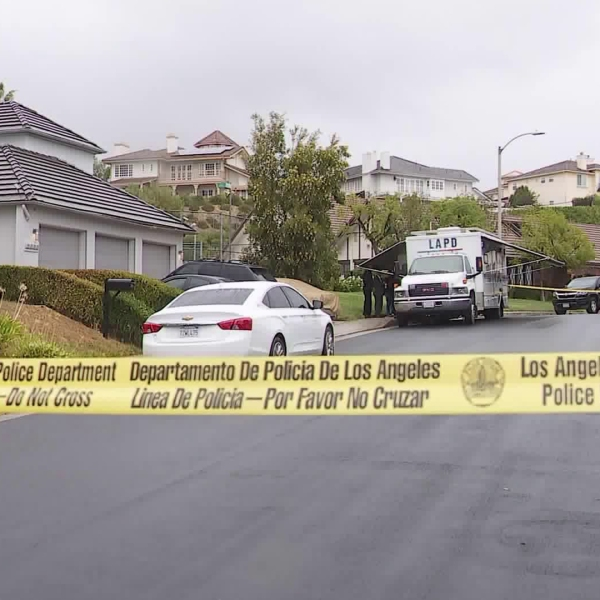 The LAPD responds to a fatal shooting involving DEA agents in Woodland Hills on Nov. 20, 2019. (Credit: KTLA)