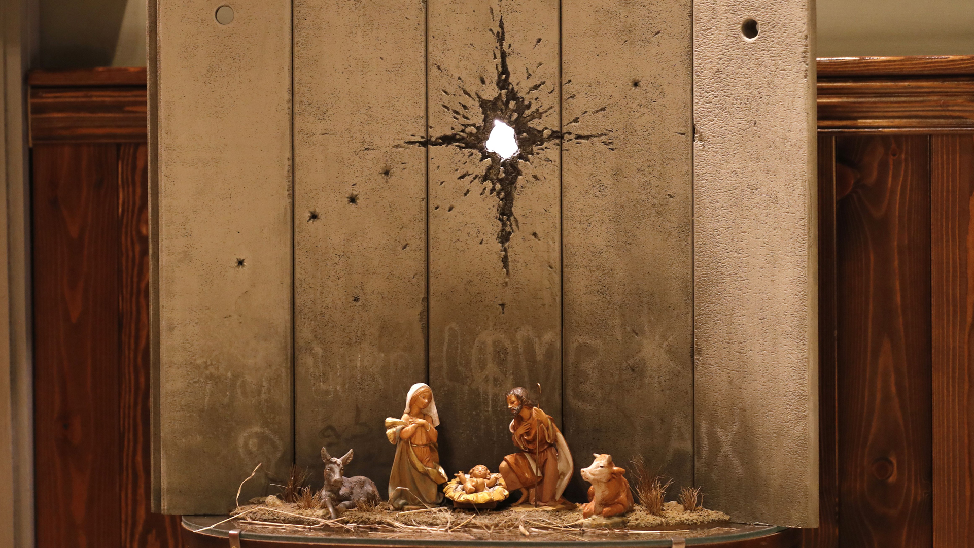 "A new Christmas-themed artwork dubbed the ""Scar of Bethlehem"" by secretive British artist Banksy is displayed at his Walled-Off Hotel in Bethlehem in the occupied West Bank on Dec. 20, 2019. (Credit: AHMAD GHARABLI / AFP) (Photo by AHMAD GHARABLI/AFP via Getty Images)"