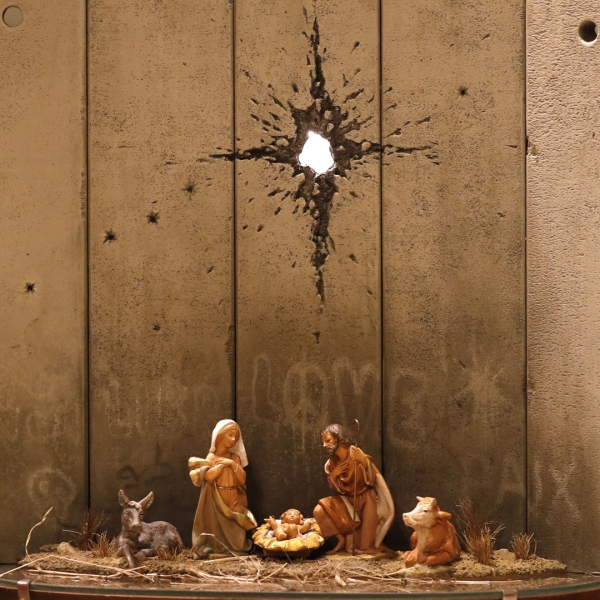 """A new Christmas-themed artwork dubbed the """"Scar of Bethlehem"""" by secretive British artist Banksy is displayed at his Walled-Off Hotel in Bethlehem in the occupied West Bank on Dec. 20, 2019. (Credit: AHMAD GHARABLI / AFP) (Photo by AHMAD GHARABLI/AFP via Getty Images)"""