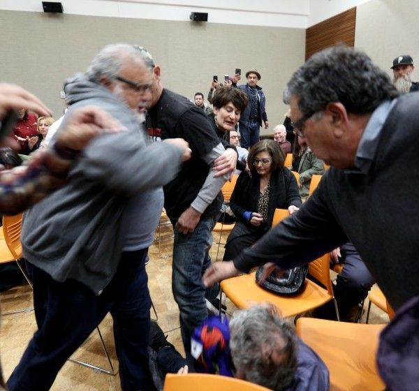 Town hall visitors on Dec. 14, 2019 tussle at the Glendale Central Library, where an Armenian group gathered to thank U.S. lawmakers for resolutions that formally recognized the Armenian genocide.(Credit: Raul Roa / Burbank Leader via Los Angeles Times)