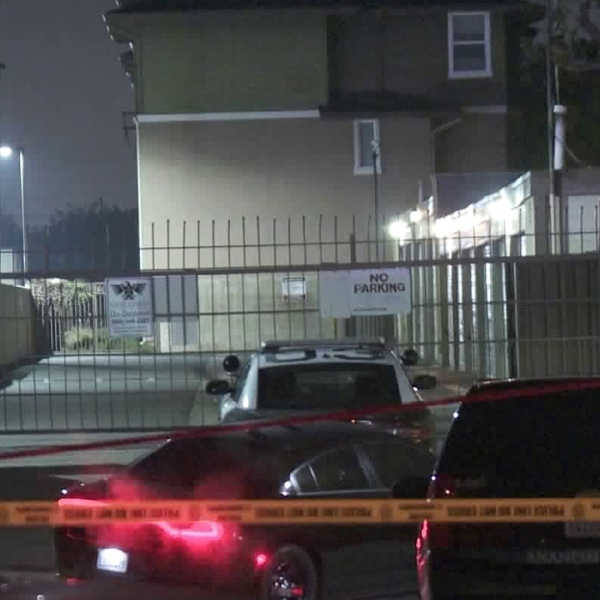 The scene of an officer-involved shooting in Anaheim is seen closed off on Dec. 13, 2019. (Credit: KTLA)