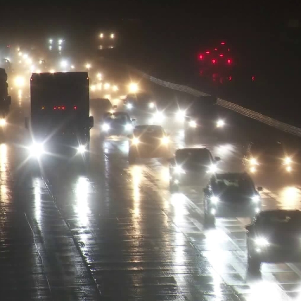 Slippery conditions are seen on the 5 Freeway through the Grapevine amid heavy snowfall on Dec. 25, 2019. (Credit: KTLA)